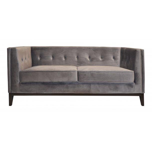 Klassisk velour sofa med knapper